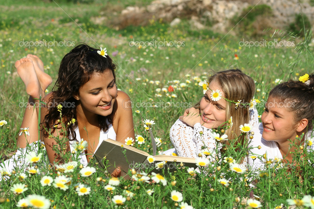 Group of happy healthy reading outdoors — Stock Photo #6361897