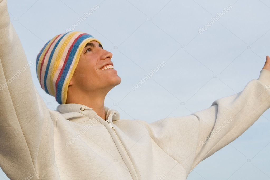 Happy young man arms raised in praise — Stock Photo #6361907