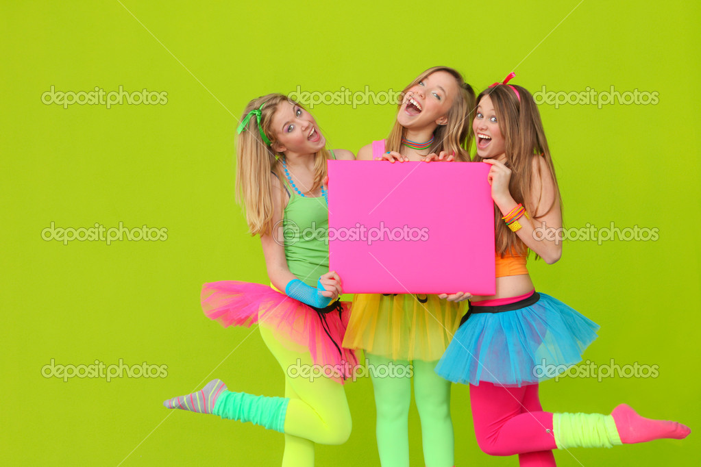 Happy party teen girls in neon fancy dress clothing with blank board — Stock Photo #6361984