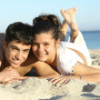 Happy young couple on summer beach vacation or spring break holiday — Stock Photo #6409135