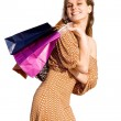 Happy woman shopper with shopping bags — Stock Photo