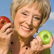 Healthy senior woman with apples for health diet concept — Stock Photo