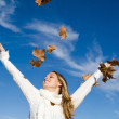 Autumn woman arms raised in happiness — Stock Photo #6409152
