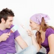 Young couple decorating painting new first home — Stock Photo