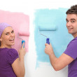Happy couple painting first home — Stock Photo