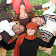 Diverse autumn group of happy young — Stock Photo
