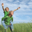 Stock Photo: Healthy happy fit active kids playing piggyback outside in summer
