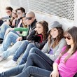 Diverse group of teens or students on campus - Stok fotoğraf