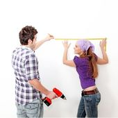 Home improvements, couple with drill — Stock Photo