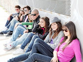Diverse group of teens or students on campus — Stok fotoğraf