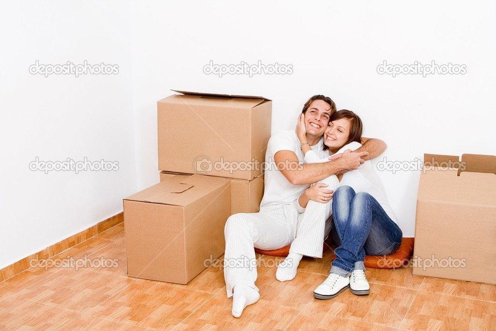 Young couple in new first home  Stock Photo #6409160