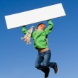 Child jumping holding, blank sign — Stock Photo #6469757