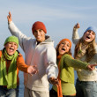 Stock Photo: Group of happy smiling teens, singing or shouting