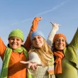 Group of diverse kids with arms outstretched — Stock Photo