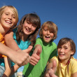 Smiling group of kids or children with thumbs up — Stock Photo
