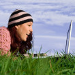 Young woman outdoor on computer laptop — 图库照片