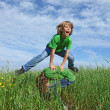 Happy healthy kids playing leapfrog outdoors in summer — Stock Photo