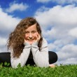 Happy healthy teen sitting on grass outdoors in summer — Стоковая фотография