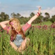 Happy smiling summer girl in meadow of flowers — Stock Photo