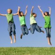 Group of kids jumping after winning — Foto Stock