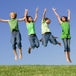 Stock Photo: Group of kids jumping after winning