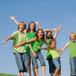Happy group of kids at summer camp singing or shouting, — Photo