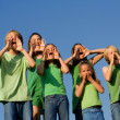 Happy group of school kids shouting, cheering or singing — Stok fotoğraf
