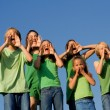 Happy group of school kids shouting, cheering or singing — Stockfoto