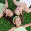 Family,. happy group of smiling sisters or young mum with kids — Stock Photo