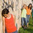 School bully or bullies bullying sad lonely child — Zdjęcie stockowe #6469827
