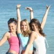Group of happy students on summer break or beach summer vacation — Stock Photo #6469834