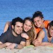 Happy young couples having fun at beach — Stock Photo #6469839