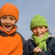 Happy smiling, winter kids, in hats and scarves — Stock Photo
