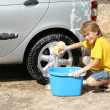 Stok fotoğraf: Child washing car helping doing chores
