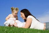 Loving mum baby and toddler — Stock Photo