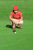 Young man playing golf calculating shot — Stock Photo
