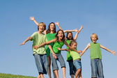 Happy group of kids at summer camp singing or shouting, — Stock Photo