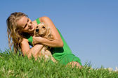 Young woman or teen girl with pet cocker dog — Stock Photo