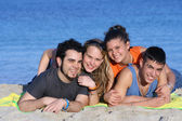 Happy young couples having fun at beach — Stock Photo