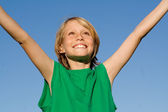 Happy smiling kid child boy with arms raised in happiness — Stock Photo