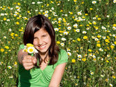 Happy smiling, summer child, holding flowers — Stock Photo