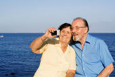 Happy senior couple on summer vacation — Stock Photo