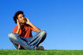 African descent youth listening to music on personal stereo mp4 or mp3 — Stock Photo