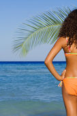 Tanned woman on beach summer vacation — Stock Photo