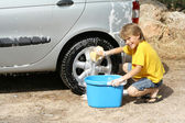 Child washing car helping doing chores — Stock Photo