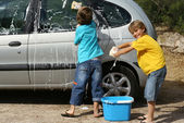 Kids washing car doing chores, — Stock Photo