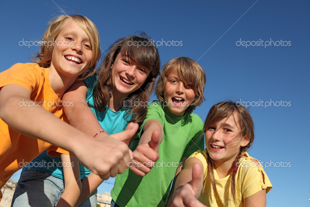 Smiling group of kids or children with thumbs up — 图库照片 #6469765