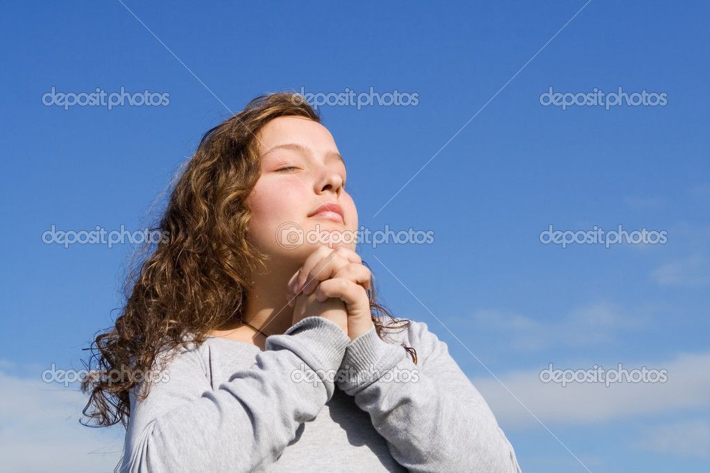 Christian child praying a prayer outdoors at bible camp  Stock Photo #6469790