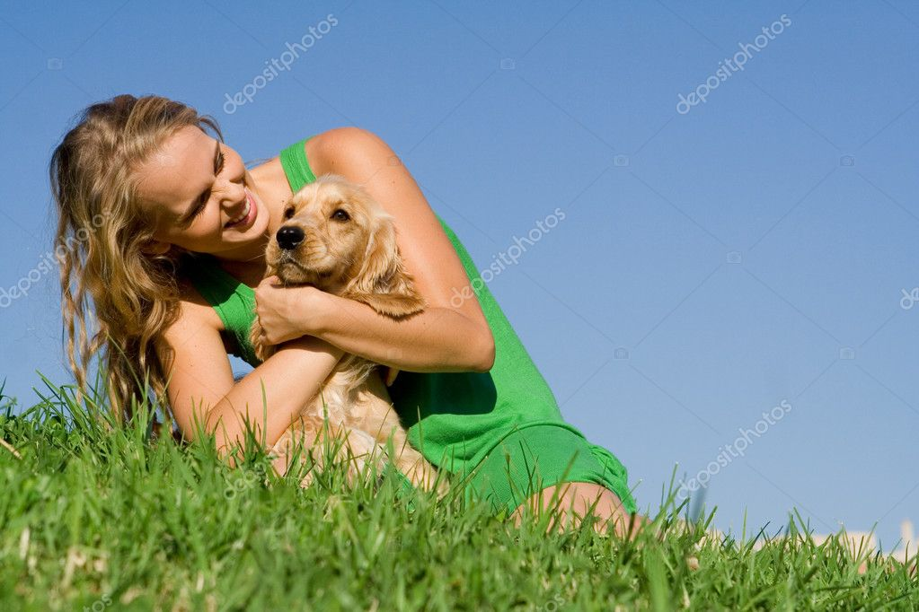 Young woman or teen girl playing with pet cocker dog — Stock Photo #6469837