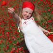 Young child picking and giving flower — Stock Photo